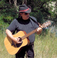 Dusty Woods with acoustic guitar.